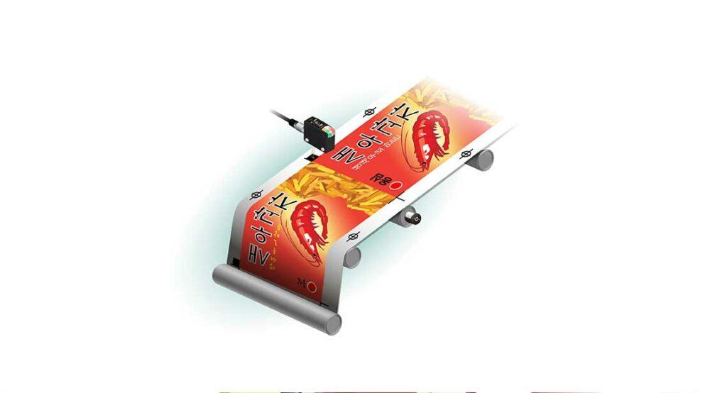 Датчики кольорових міток використовуються для виявлення ріжучих міток під час виготовлення пакувального матеріалу.